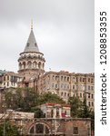Small photo of Galata Tower, land view. Galata tower The pre-Byzantine Galatians went up to their people and the watch tower of the Golden Horn was later used as a fire observation tower. Istanbul, Turkey, in 2018.