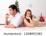 young pair conflicting at... | Shutterstock . vector #1208892382