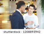 young restaurant manager gives... | Shutterstock . vector #1208893942