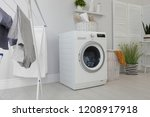 laundry room interior with... | Shutterstock . vector #1208917918