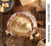 bread bowl with cheese fondue | Shutterstock . vector #1208919385