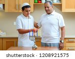 jewish boy and dad with deeper... | Shutterstock . vector #1208921575