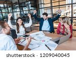 happy successful business team... | Shutterstock . vector #1209040045