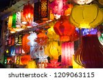 a streetside shop selling... | Shutterstock . vector #1209063115