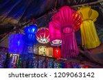 a streetside shop selling... | Shutterstock . vector #1209063142