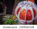 a streetside shop selling... | Shutterstock . vector #1209063148