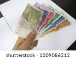 pakistani currency mix note... | Shutterstock . vector #1209086212