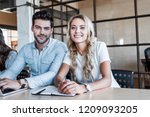 happy young business colleagues ...   Shutterstock . vector #1209093205