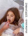 sick little girl | Shutterstock . vector #1209144862