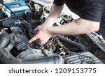 the master repairs under the... | Shutterstock . vector #1209153775