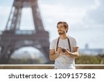 paris eiffel tower tourist with ... | Shutterstock . vector #1209157582