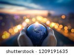 the globe earth in the hands of ...   Shutterstock . vector #1209191635