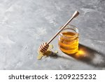sweet floral natural honey in a ... | Shutterstock . vector #1209225232