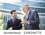 business people having a... | Shutterstock . vector #1209246775
