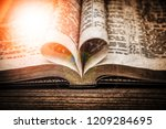 old photo bible and happy...   Shutterstock . vector #1209284695