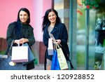 smiling girls shopping in the city - stock photo
