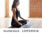 slender asian yoga girl wearing ... | Shutterstock . vector #1209330418