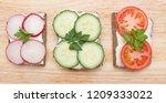 healthy open sandwiches on a... | Shutterstock . vector #1209333022