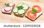 healthy open sandwiches on a... | Shutterstock . vector #1209333028