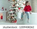 child on christmas | Shutterstock . vector #1209408262