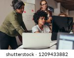 software engineers working on... | Shutterstock . vector #1209433882