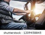 truck driver behind the wheel....   Shutterstock . vector #1209458845