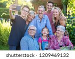 in the summer  a family of... | Shutterstock . vector #1209469132