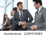 businessman by handshake... | Shutterstock . vector #1209474085