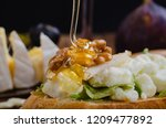 bruschetta with cheese  fruit... | Shutterstock . vector #1209477892