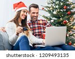 couple sitting on sofa and... | Shutterstock . vector #1209493135