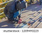 welder working on welding metal ... | Shutterstock . vector #1209493225