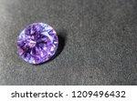 natural purple sapphire gemstone | Shutterstock . vector #1209496432