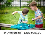 two boys playing with modern... | Shutterstock . vector #1209505192