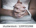 bridge entwining her fingers... | Shutterstock . vector #1209531088