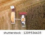 harvesting. combine harvester... | Shutterstock . vector #1209536635