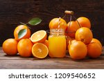 glass jar of fresh orange juice ... | Shutterstock . vector #1209540652