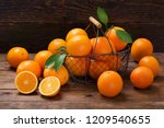fresh orange fruits with leaves ... | Shutterstock . vector #1209540655