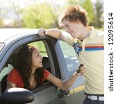 Small photo of Happy teen shows off car