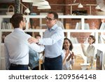 satisfied businessman handshake ... | Shutterstock . vector #1209564148