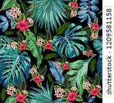 tropical leaves and flowers on... | Shutterstock . vector #1209581158