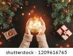 female hands holding christmas... | Shutterstock . vector #1209616765