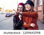 outdoors fashion portrait young ... | Shutterstock . vector #1209642598