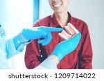 dentist talking to smiling male ... | Shutterstock . vector #1209714022
