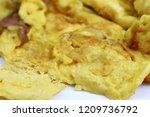 close up macro of thai omelet ... | Shutterstock . vector #1209736792