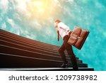 businessman standing on stair... | Shutterstock . vector #1209738982