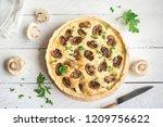 mushroom quiche pie  with... | Shutterstock . vector #1209756622
