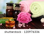 spa setting  on  green background - stock photo