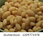 a bowl of cooked navy bean or... | Shutterstock . vector #1209771478