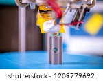 print parts on a delta 3d... | Shutterstock . vector #1209779692