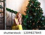 beautiful woman in a yellow... | Shutterstock . vector #1209827845